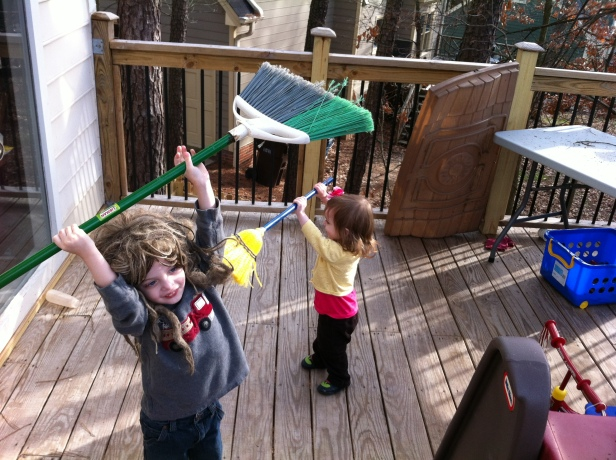 Kids with brooms
