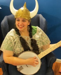 Summer Kinard with banjo and viking helmet