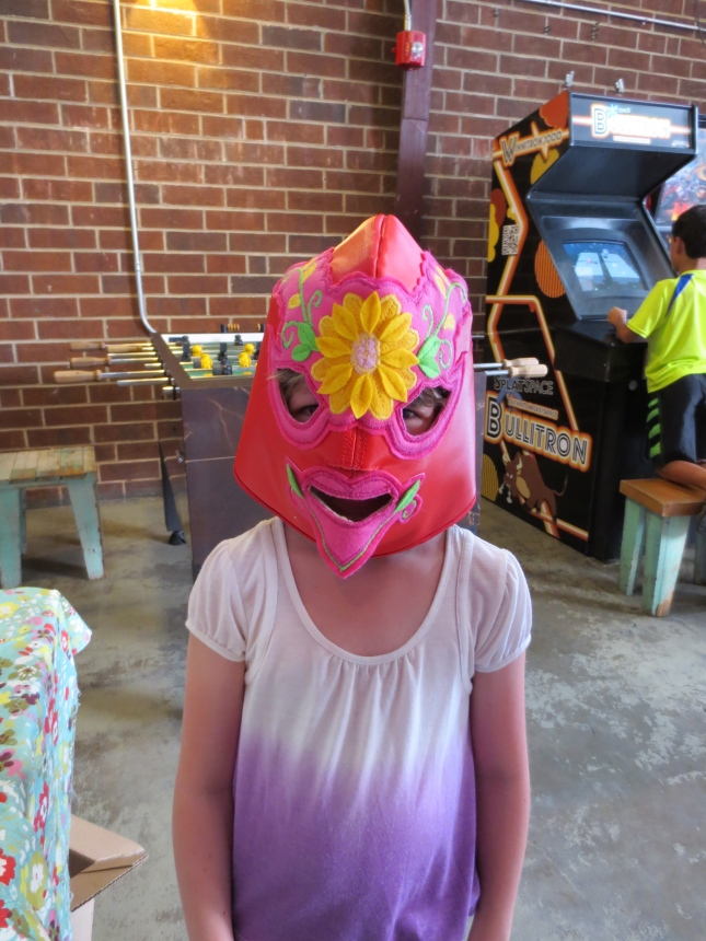 child in lucha libre mask