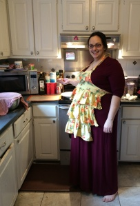 The author, barefoot and pregnant and cooking. The twins are tucked under that apron!
