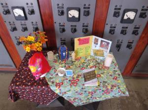 I loved the elements of the story: reuse, fabrics, lucha libre, home shrines, flowers, interaction with saints. It was easy to tell people about my book! (This is the table I sat up at my launch and other readings.)