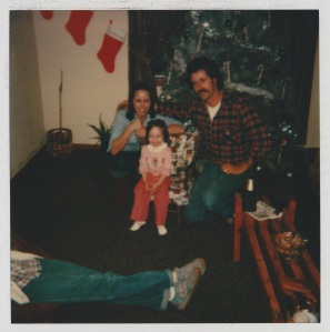 My parents and me, their first Christmas married when I was 2. Dad's ALS was related to his time serving in the Army in the 70s. We had no idea back then what he would go through.
